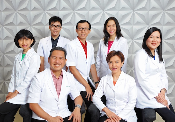 seven dentists smiling at the camera